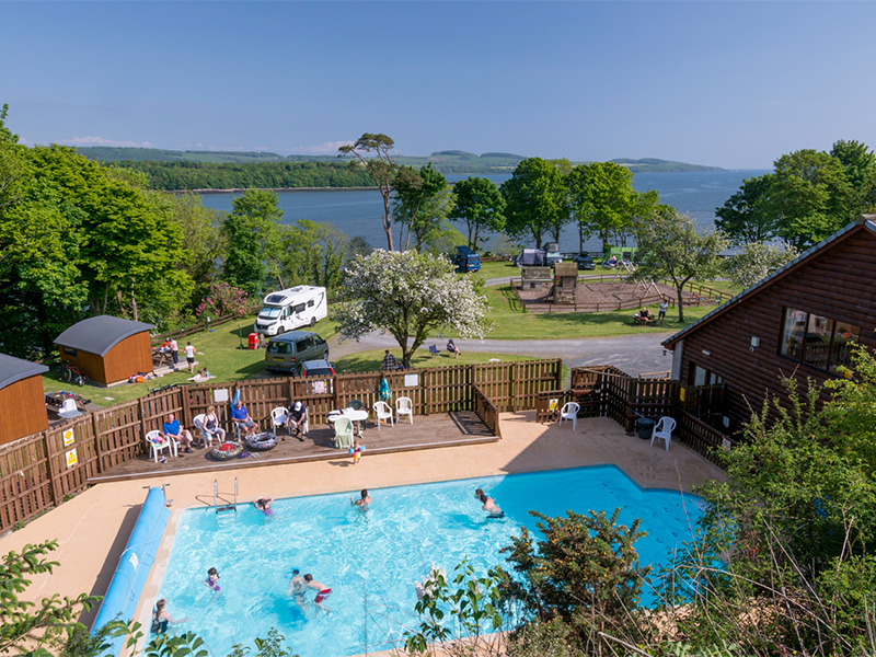View over outdoor pool and children's play area